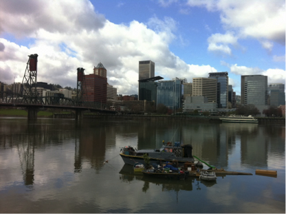 A boat-house on the Willamette River, just across from downtown Portland. Source: Author.